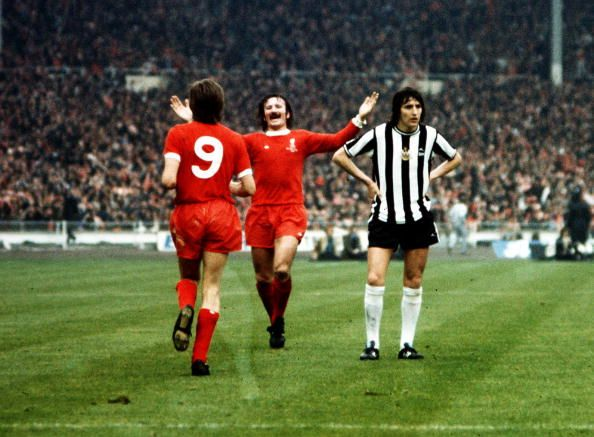 Football 1974 FA Cup Final Wembley Stadium 4th May Liverpool 3 v Newcastle United 0 Liverpool's Steve Heighway is congratulated by Tommy Smith after...