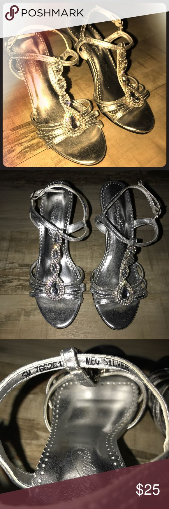 Michelangelo Silver Dress Heels W/ Jewels Bought straight from David's Bridals, these Michelangelo silver dress heels can dress up any solid gown/prom dress. They are in nearly perfect condition, and have only been worn once for an event. Pre-loved, comfortable and super easy to walk around in. I'm not a heel person, but these did not bother me AT ALL throughout the night or the day after. Michelangelo Shoes Heels