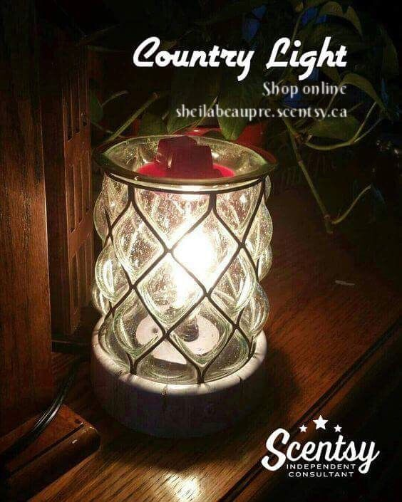SCENTSY Country Light Warmer  A little bit rustic but also refined enough for formal settings. A distressed wood look base is the perfect accompaniment to the large grid grill on the shade, allowing the light from the specialty bulb to shine forth and add interest.  Choose a hearty, full bodied Scentsy fragrance for this robust warmer, harkening back to the time when a light like this let you know you were welcome.