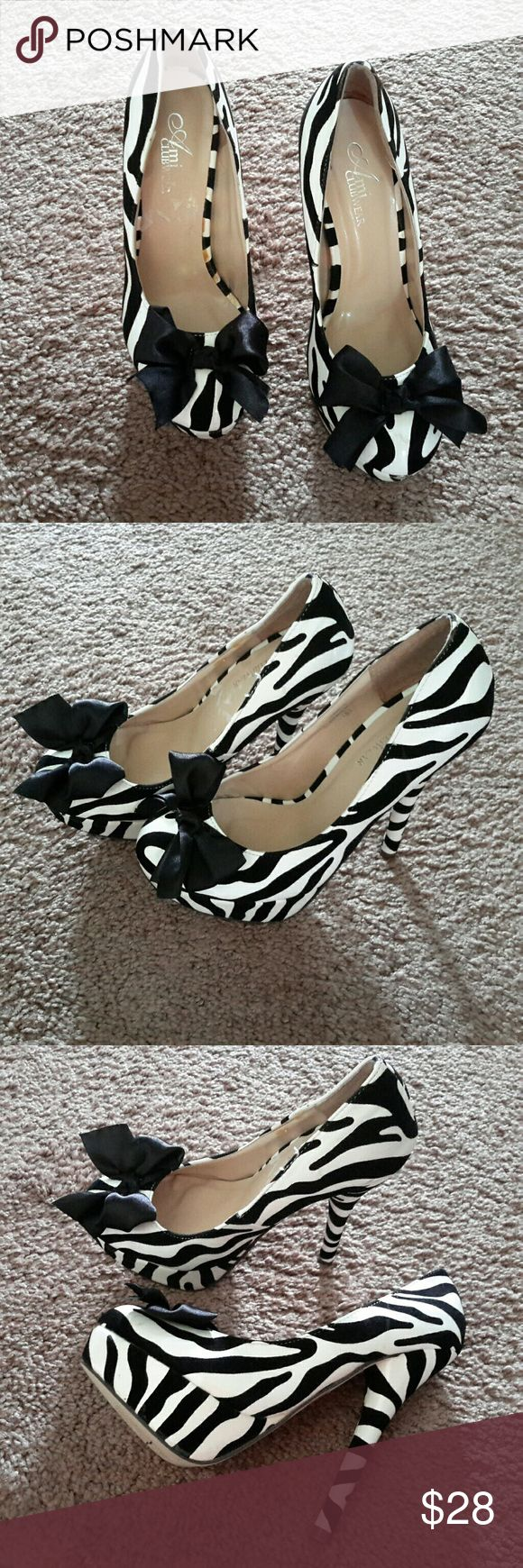 "AMI Clubwear Zebra Heels Stunning animal print heels with black bow 5 1/2"" Heel  Size 6,  2 1/2"" Wide Closed toe with cushioned footbed Barely worn AMI CLUBWEAR  Shoes Heels"