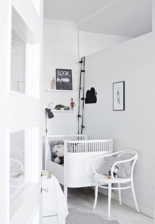 cozy simple white with black and grey accents baby nursery. chic nurserys for small spaces