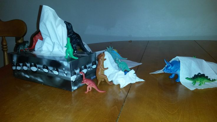 November 5, 2014: The dinos have gotten into the tissue box and are playing on the box, on the tissues, and hiding underneath.