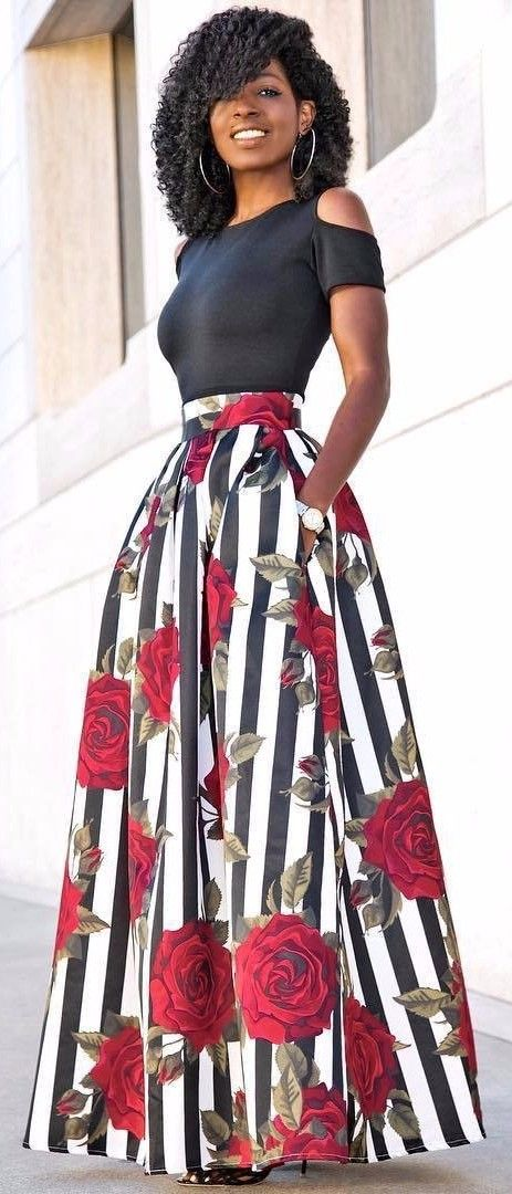 Maxi skirt decorated with big roses paired with an cold-shoulder top is the best clothing combo to get as soon as possible