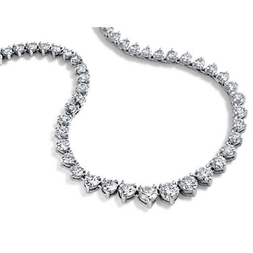 Exceptional radiance, this diamond necklace features 115 graduated brilliant cut round diamonds hand-set in 14k white gold for maximum fire. 10 carat total diamond weight. Graduated Diamond Eternity Necklace in 14k White Gold (10 ct. tw.)