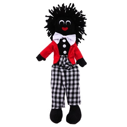 Old fashioned Gollywog doll. Have not seen these for a long time.  The Gollywog originates from Eygpt around the end of the 19th Century. Young Egyptian children would play with black stuffed material dolls. These dolls were purchased or given as gifts by English government officals who then brought them back to England.