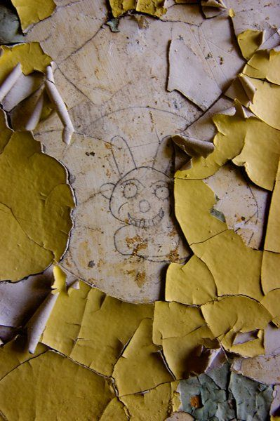 Rabbit.  Brushing away the layer of paint in one of the rooms of the Verden Psychiatric Hospital revealed writings and drawings from a patient who seemed to have gotten ahold of a pencil or similar item.