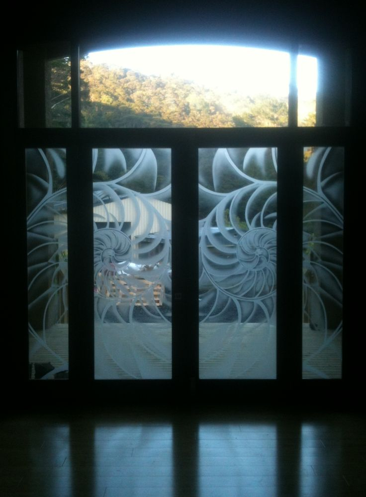 Custom designs sandblasted onto glass at Glassarts Design in Kingsland.