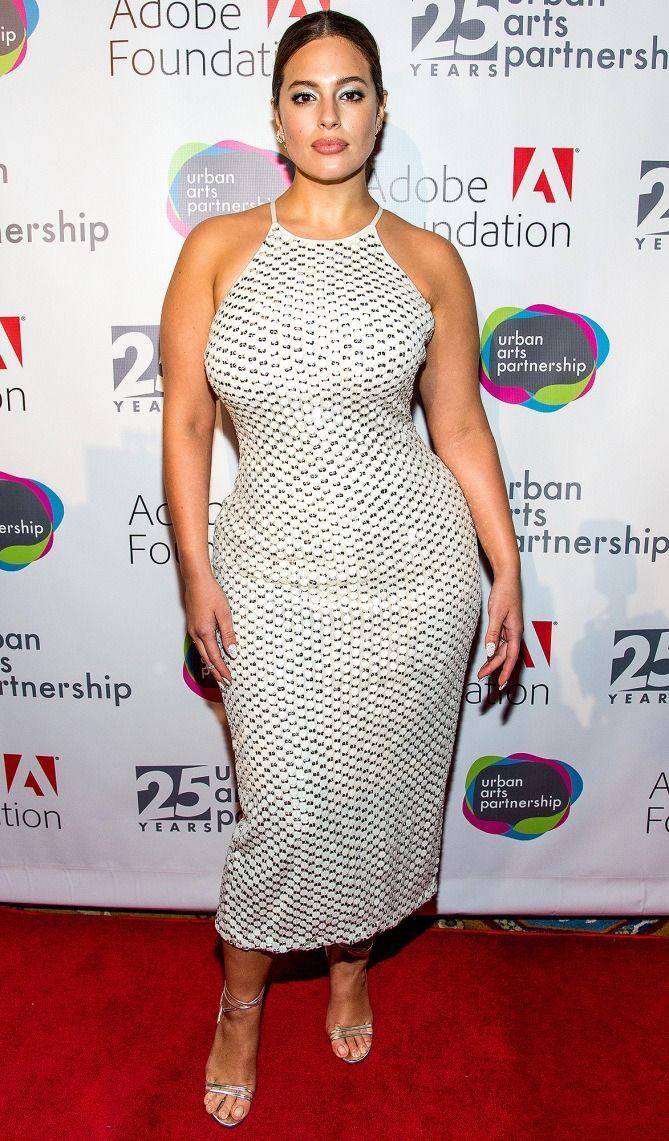 Ashley Graham in a white halter midi dress