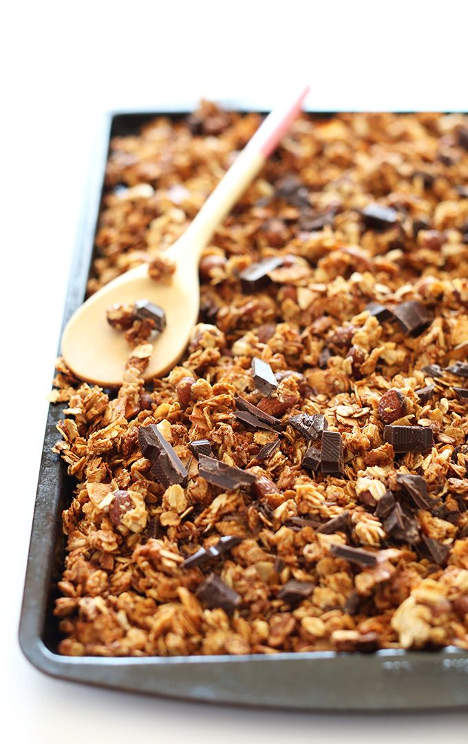 Simple, super crispy Almond Joy Granola with shredded coconut, almonds, toasty rolled oats and specks of dark chocolate! A healthier way to indulge. Vegan and gluten free friendly.