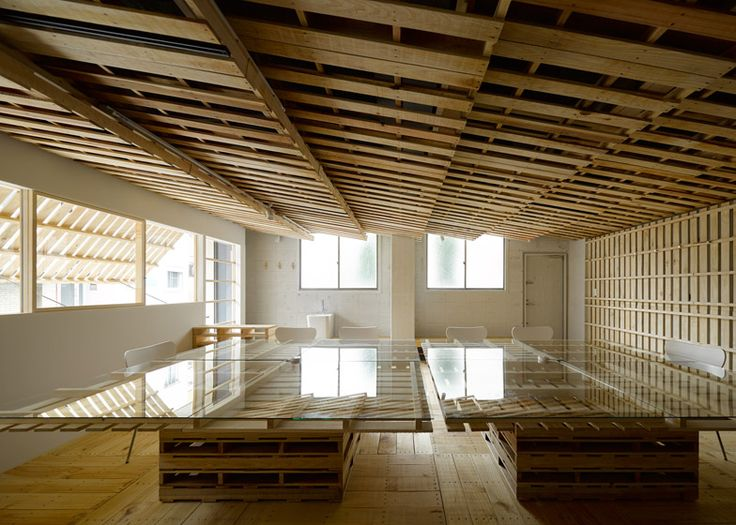 Deconstructed pallets used to dress a Tokyo office in planks of timber.