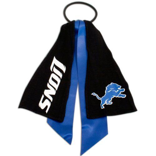 Detroit Lions Streamer Ponytail Holder by Football Fanatics. $5.95. Ribbon bow detail. Screen print graphics. Elastic band. Perfect for game day. Ladies, top off your Lions game day garb with this fun streamer ponytail holder featuring your team's logo and name printed on cloth streamers with team-colored ribbons. It's perfect for keeping your hair out of your eyes so you can catch all your favorite team's biggest plays!Elastic bandRibbon bow detailScreen print graphics...