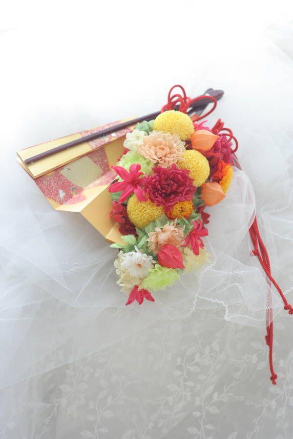 この扇にあしらう和装用ブーケを知ったのがきっかけで一会に花を頼んでくださった花嫁様。お式が終わった2日後にメールをいただいたのですが「扇ブーケはさっそく、...