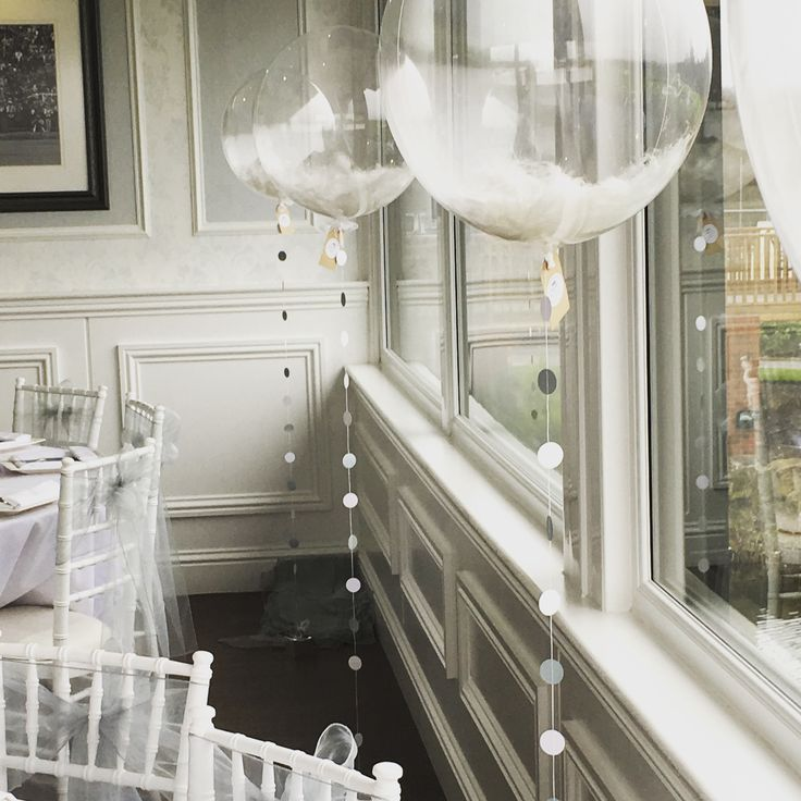 Beautiful white feather bubble balloons with silver and white confetti strings for a pretty dining room at a Hampshire country club by The Feather Balloon Company. Available on our website. https://noahxnw.tumblr.com/post/160694637376/braids-inspirations