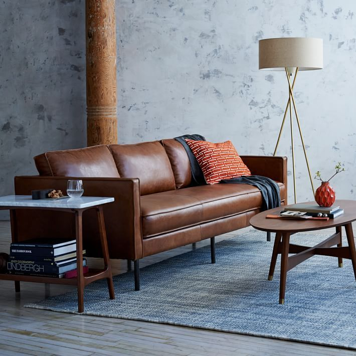 Our Axel Leather Sofa features the highest quality aniline-dyed leather on a simple industrial form, with bench cushioning, flanged edges and modern metal legs.