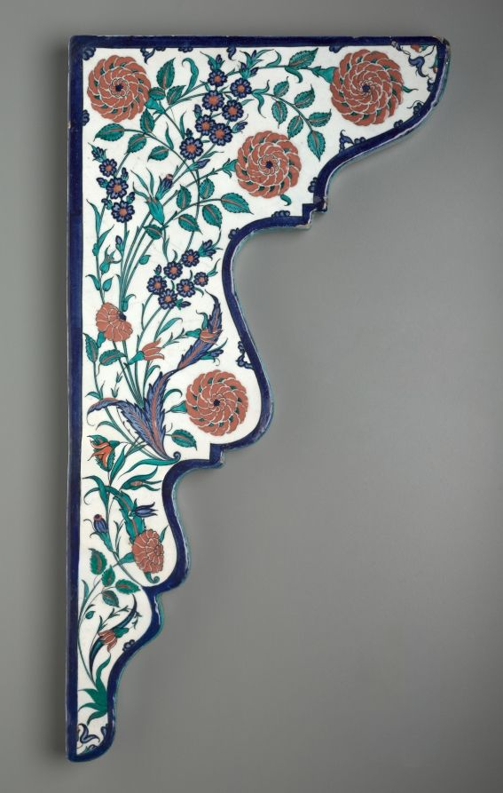 Tile Spandrel with Floral Sprays, c. 1570-1575 - Turkey, Iznik, Ottoman Period, 16th century - Fritware with red slip and underglaze-painted design, Overall: 76.00 x 29.90 x 2.50 cm (29 7/8 x 11 3/4 x 15/16 inches).