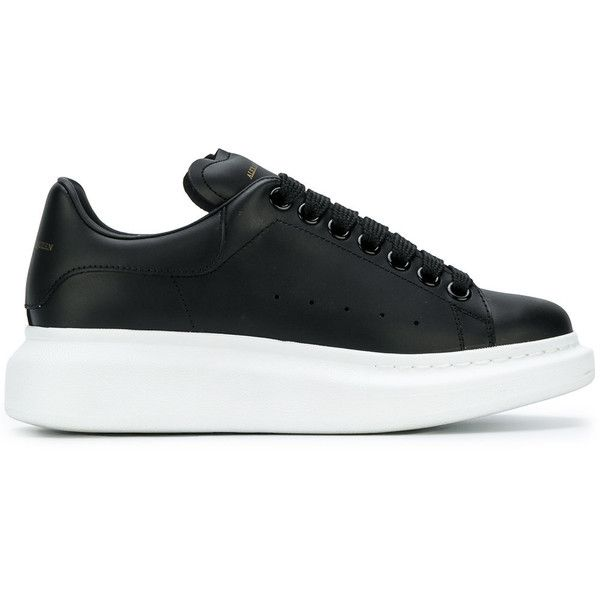 Alexander McQueen extended sole sneakers found on Polyvore featuring shoes, sneakers, black, leather sneakers, black leather trainers, black trainers, round toe sneakers and leather lace up shoes