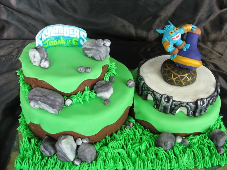 Skylander Cake!!  Everything is edible... I am a cake decorator so I am lucky I don't have to buy them...  so the rocks are rice cripies covered in fondant and so is Super Gulp!