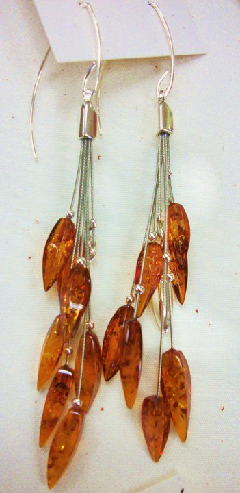 We have gorgeous Russian amber jewelry set in sterling silver.   Many Hands Trading