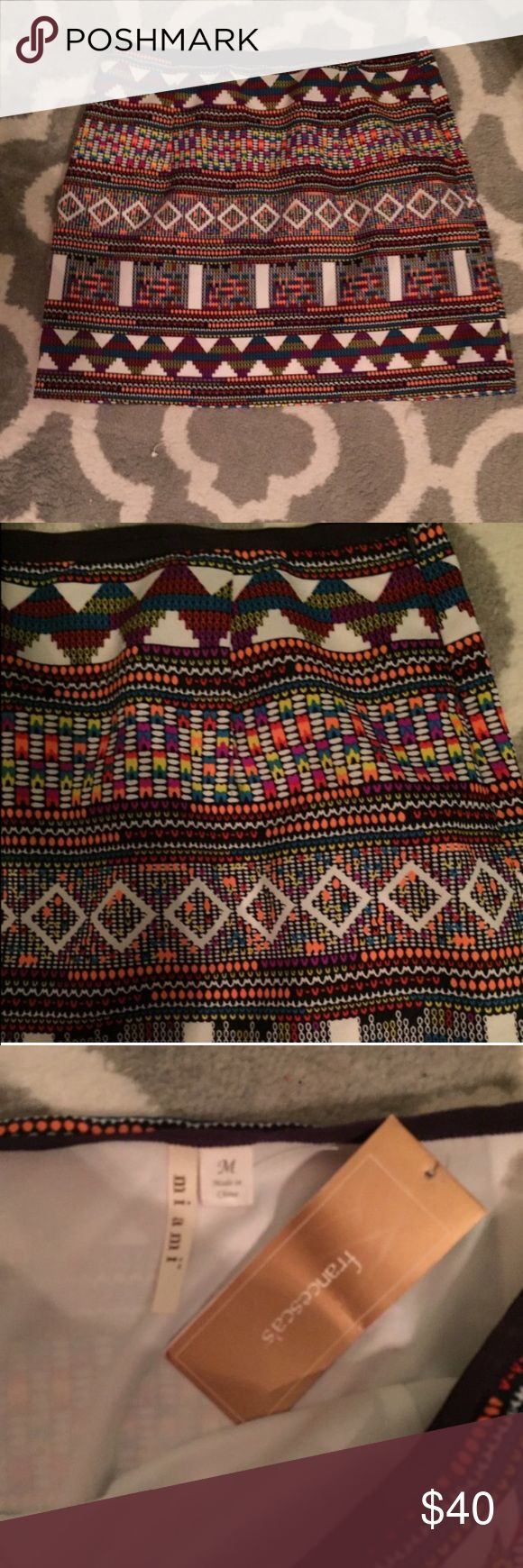 Francesca's collection tribal print skirt med NWT Francesca's collection tribal patterned mini skirt with zip up side NWT. Size medium. Perfect condition, pattern also on back. Very bright and colorful. Francesca's Collections Skirts Mini