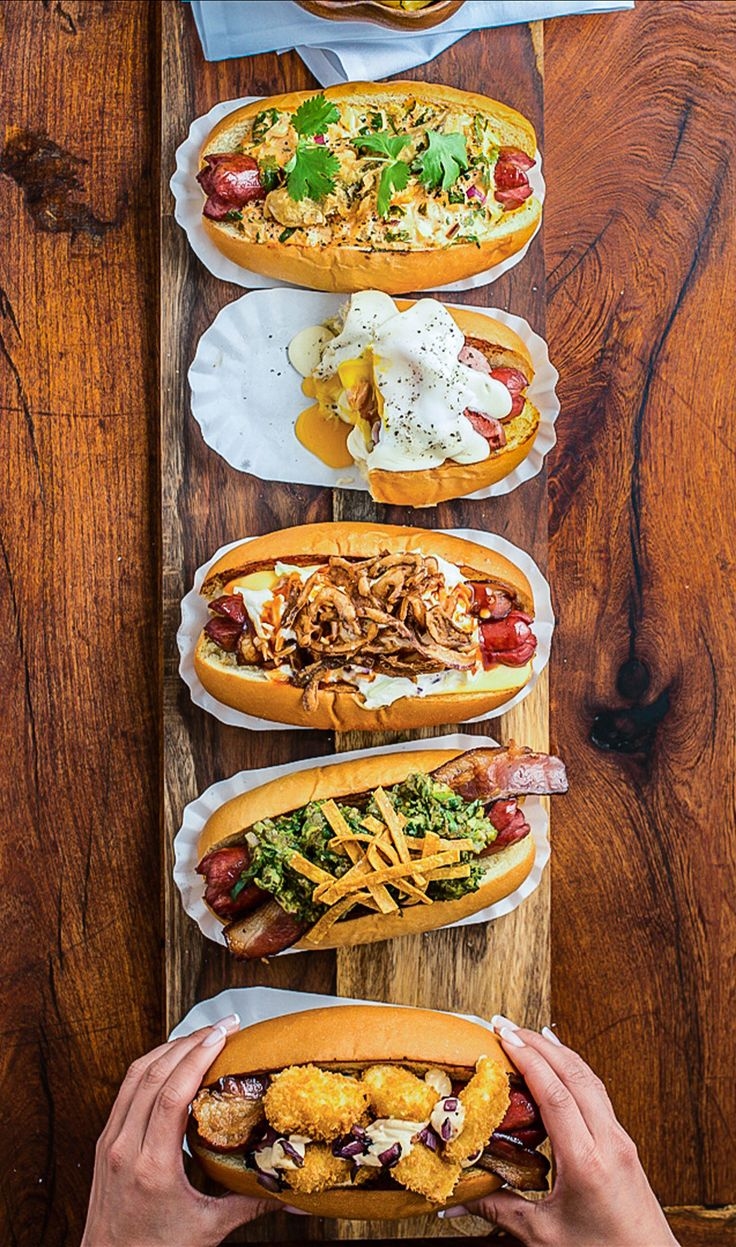 For National Hot Dog Day, explore the 8 best, fanciest hot dogs in America.