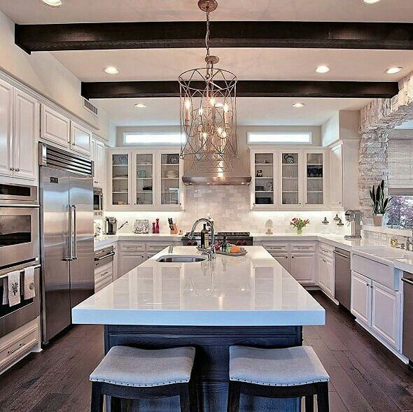 White kitchen. Exposed beams. Love the thickness of the stone on the island.