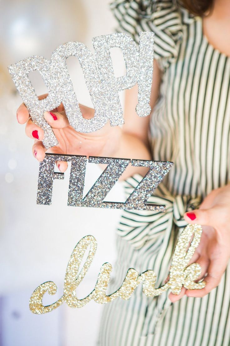 Upgrade your NYE party photo booth with these chic 'n' shiny decor ideas!