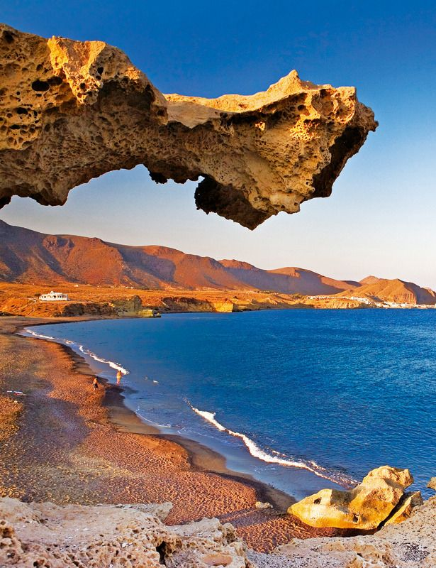 Andalucía / Spain - Cabo de Gata, Almería, Spain. - The eponymous mountain range of the Sierra del Cabo de Gata with its highest peak El Fraile is Spain's largest volcanic rock formation with sharp peaks and crags in red/ochre-hues. It falls steeply to the Mediterranean Sea creating jagged 100-metre (330 ft) high cliffs, which are riven by gullies leading to hidden coves with white sandy beaches, some of the most beautiful in Andalucia.