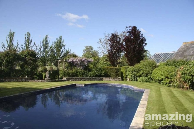 Classic English garden with swimming pool