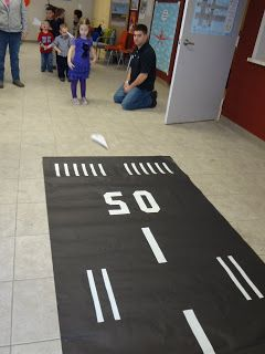 "Make a paper ""runway"" for kids to fly their planes down."