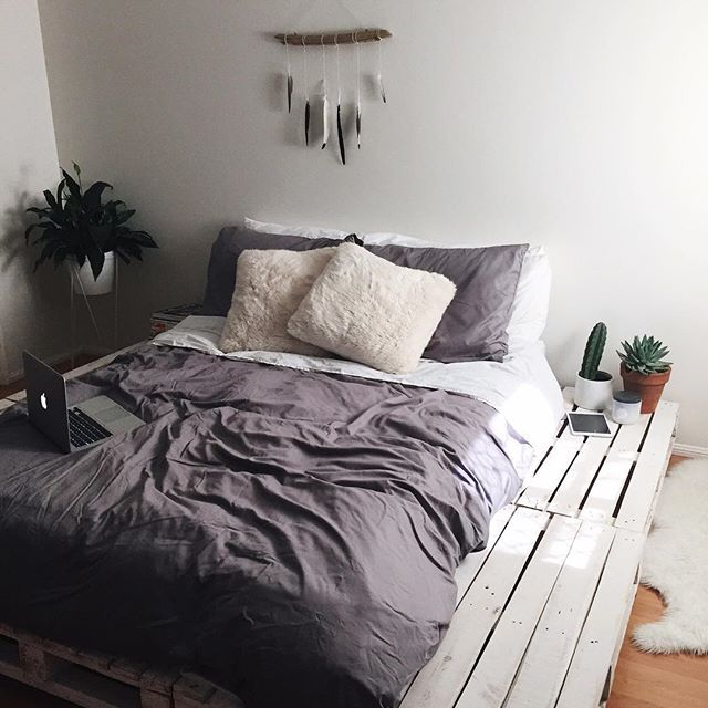 Repurposed wood creates a great looking platform for the bed in this cozy bedroom featuring simple touches of south western decor.