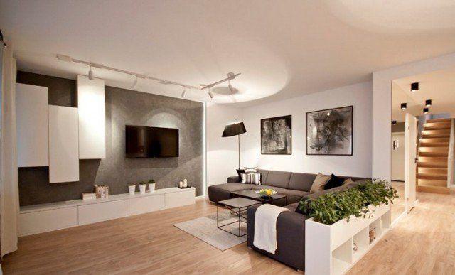 ecran-plat-mural-mur-aspect-béton-meubles-blancs-canapé-gris-anthracite-parquet écran plat mural