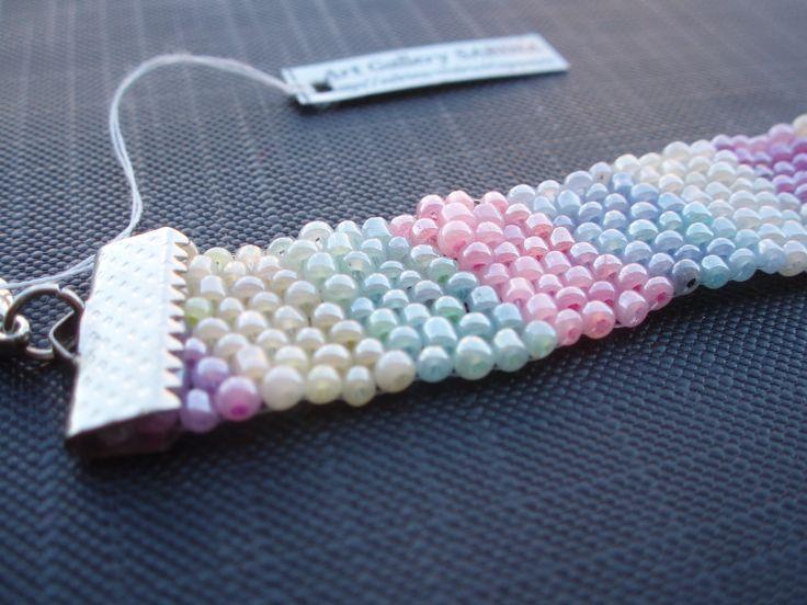 https://www.etsy.com/listing/192753304/pastel-multi-color-bead-bracelet?ref=listing-shop-header-0