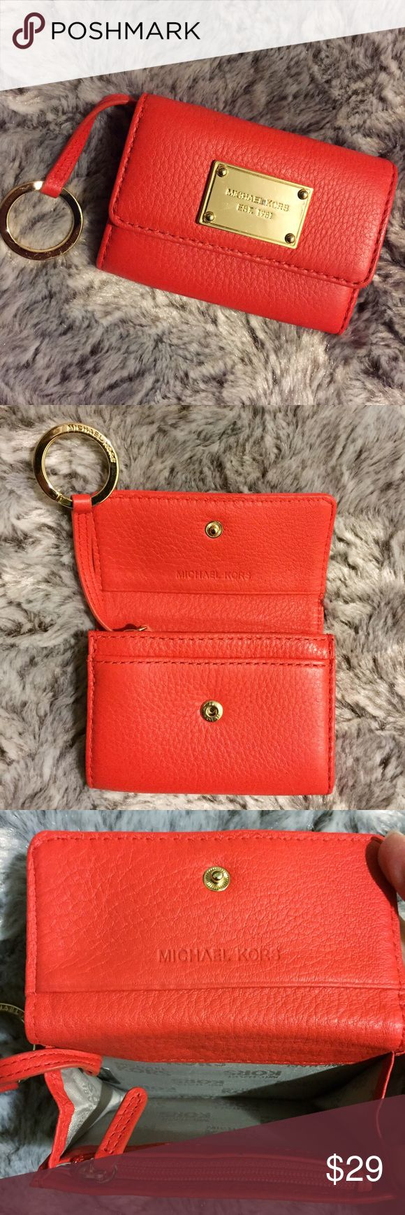 Michael Kors Leather Keychain Wallet Pre-loved in great condition. Only signs of wear are scratches on the front gold metal plate. There is also a mark between Michael & Kors on the metal plate. This wallet comes in a gorgeous red orange color. Interior has a small zippered pouch for change, as well as credit card slots. Some scratches on the metal keychain hook. Hook easily folds inside if you don't want your keys dangling outside of the wallet. Perfect size if you are traveling light! No…
