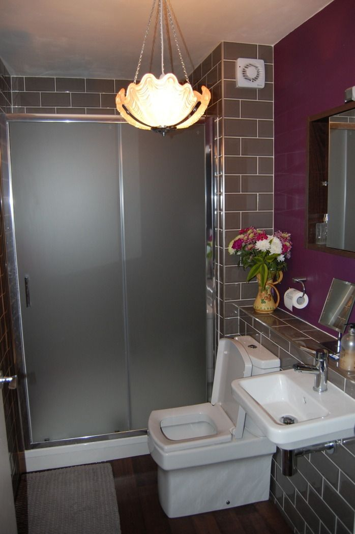 This shabby chic styled bathroom belonging to Martin in Bracknel really stands out. It's fitted with an old moody light and dark purple walls. Very stylish. l #VPShareYourStyle