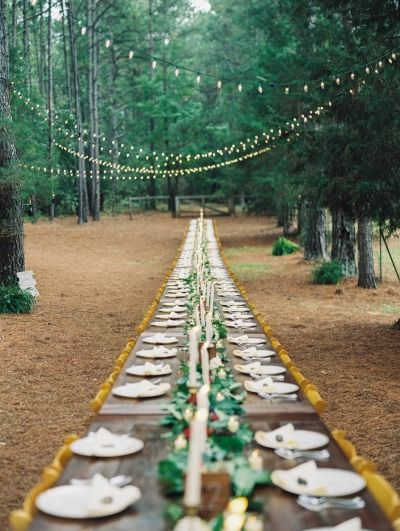 A table for 100 people, aka the entire wedding: http://www.stylemepretty.com/2015/01/22/rustic-outdoor-geogia-wedding/ | Photography: Laura Gordon - http://www.lauragordonphotography.com/