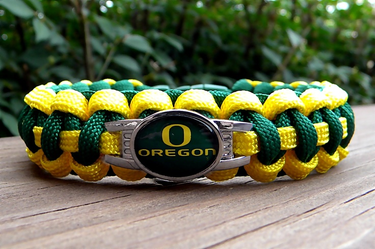 Custom Handmade Oregon Ducks Team Paracord Bracelet with an Officially Licensed NCAA Charm Free Continental US Shipping. $17.00, via Etsy.