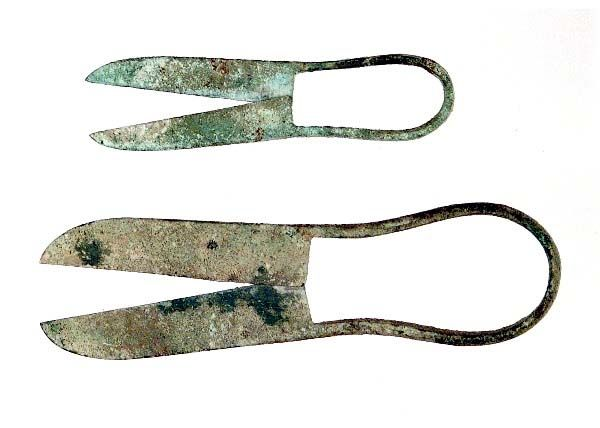 Roman Scissors.    FYI:Scissors were invented in Egypt about 1500BC and made of a single piece of metal (bronze).  About 100AD, the Romans improved on this design by having the blades cross each other..kind of like today's nippers.    Crewel Jewels Scissor Museum