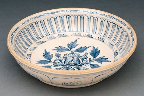#Bowl  #Vietnam; 15th century  Although the peony in the interior of this bowl is a #Chinese motif, its placement as the central medallion is distinctly Vietnamese; peonies on Chinese #ceramics are more likely to occupy the horizontal register on vases. The base of the bowl is covered with a chocolate-brown mixture of clay and water, or slip. #history #museum #art #asia #stoneware