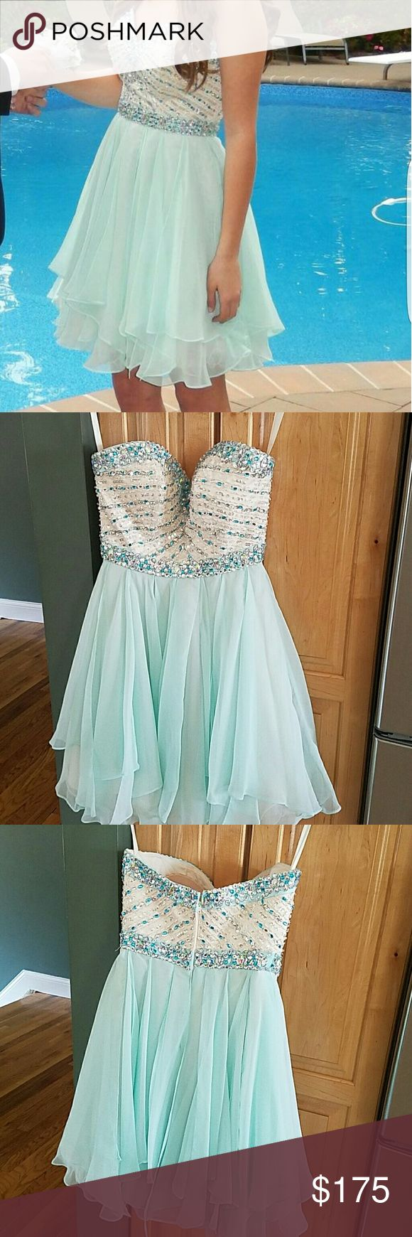 Girls sparkly short Prom/sweet 16 Mori Lee dress Beautiful mint beaded short  Mori Lee Prom/Sweet 16 size 4 dress. ( my daughter wears a size 0) so if your a size 0 this would be great!!    We added bra inserts to the dress.  If you have any questions,  please feel free to send me a message.  Thanks for looking!!!!?? Mori Lee Dresses Prom