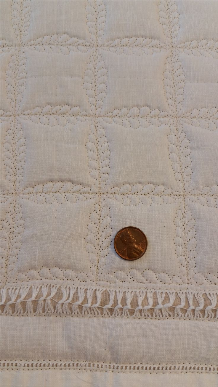 """Mary Stark used the 2"""" Ultimate Shape stencil to create this overall design on a linen wholecloth quilt.  LOVE her itsy feathers!"""