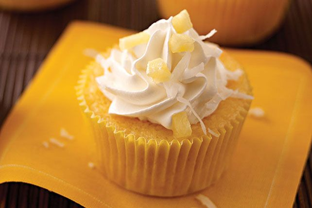 Piña Colada Cupcakes ...... Do you like piña coladas and tasty cupcakes? What about pineapples and coconut? Well, these cupcakes were made with you in mind.