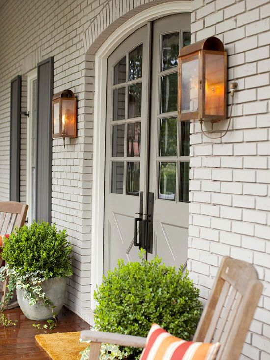 Give your exterior a polished look with lighting and personal touches. More front entry lighting and accessories: http://www.bhg.com/home-improvement/door/exterior/front-door-lighting-and-accessories/?socsrc=bhgpin072513archedoor=4
