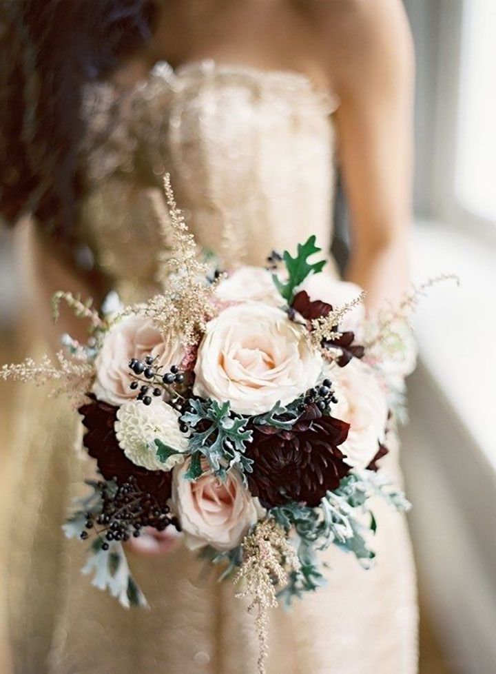Elegant bouquet with gorgeous texture! We love the pale pink roses with darker burgundy dahlias and privet berries