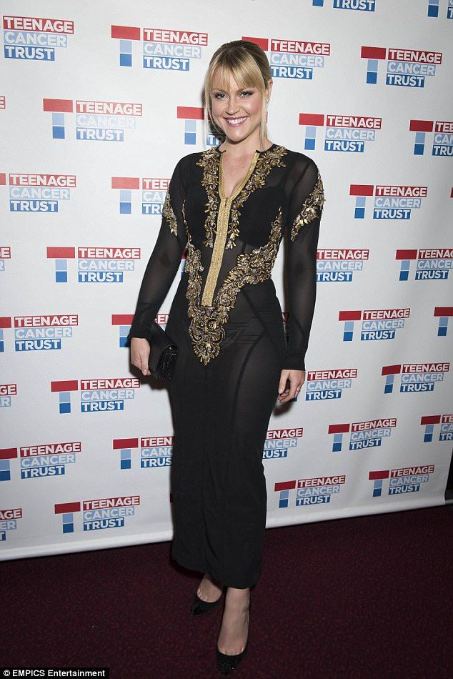 Golden girl: Singer Camilla dazzled in a sexy mesh black dress, adorned with shimmering gold embroidery and glittering lining