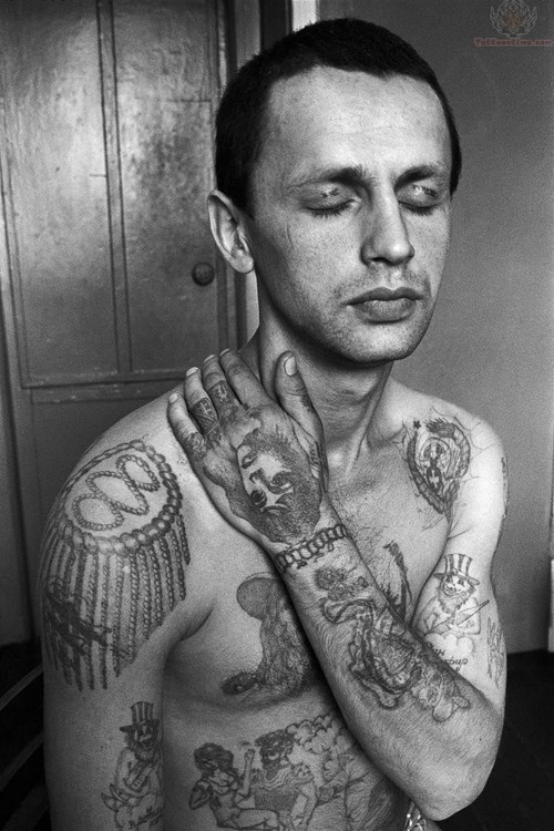 Kiss Of A Rose One of the most notorious styles of ink in Russian prison/gang circles, are those that tell stories about the wearer. The most common piece is a chest design of a rose, which is often associated with the Russian Mafia.