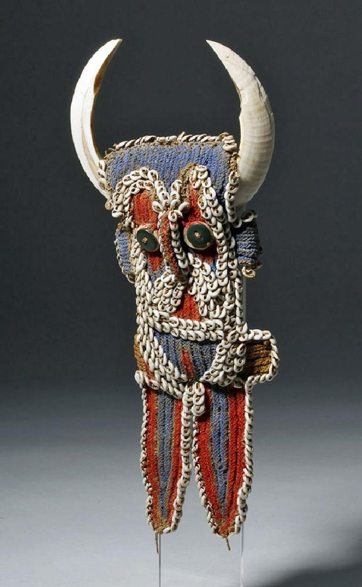 Papua New Guinea, North Maprik District, Abelam people, 20th century CE. This is a human figure effigy ornament, said to be worn by chiefs both during war and during dances - they are only for men and only for wear when in full ceremonial dress and face paint. It is called a karawut (also karahut or kara'ut), a type of body adornment that is in a rough human body shape which is two dimensional aside from a protruding nose. The shape, made of knotted bush string dyed red, blue, and brown, is…