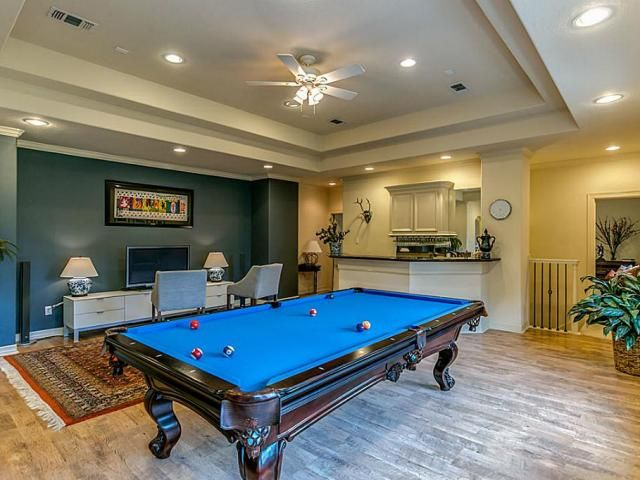 Dream Game Room with large wet bar! That's a full size tournament pool table! 31019 Edgewater Dr, Magnolia Property Listing