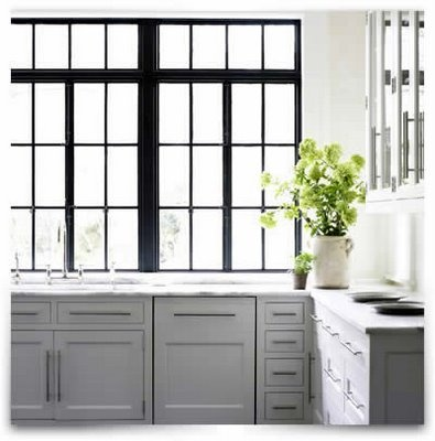 love the modern stainless steel benchtop with traditional shaker style cupboards