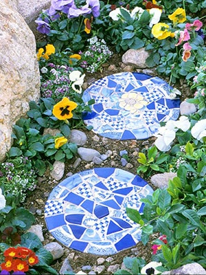 Stepping-stones make great garden additions. More mosaic garden ideas: http://www.midwestliving.com/garden/design/how-to-create-mosaic/