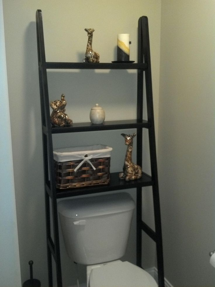 Took a ladder shelf and left out the bottom 2 rows to fit perfectly over the toilet! Super easy to put together and makes for extra storage space without looking too bulky.